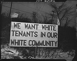 256px-White_sign_racial_hatred.