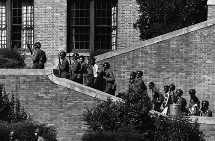 Soldiers from 101st Airborne escort Little Rock Nine students into Central High School