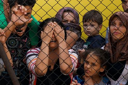 Women_and_children_among_Syrian_refugees_striking_at_the_platform_of_Budapest_Keleti_railway_station._Refugee_crisis._Budapest,_Hungary,_Central_Europe,_4_September_2015._(3)
